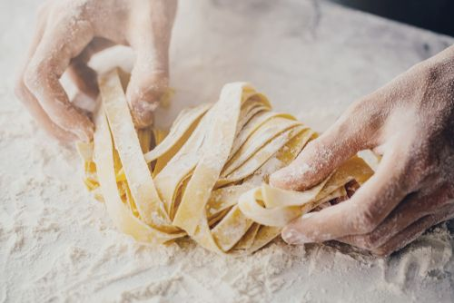 close up of a person making spaghetti