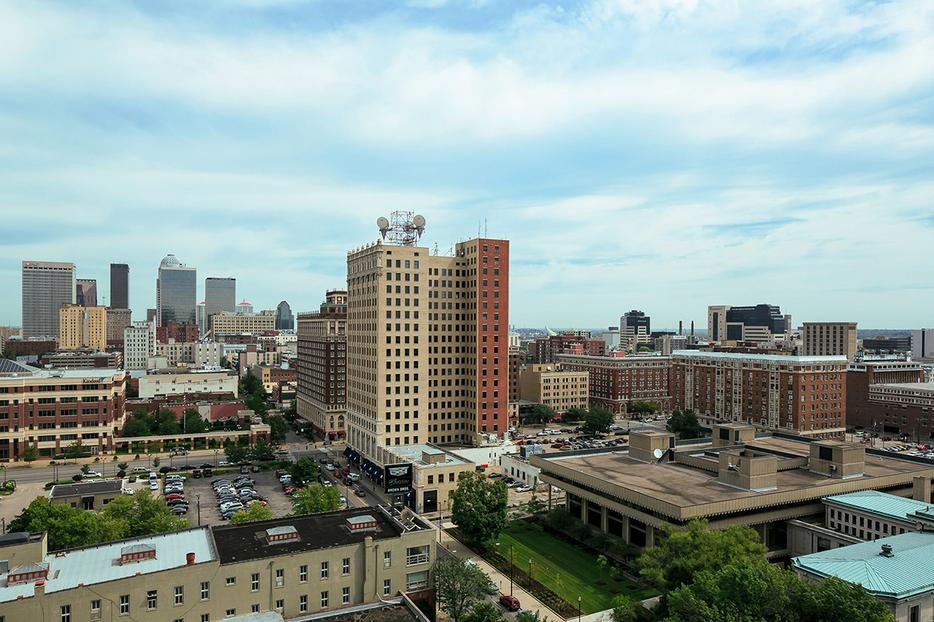 This minimalistic apartment has a perfect view of downtown Louisville